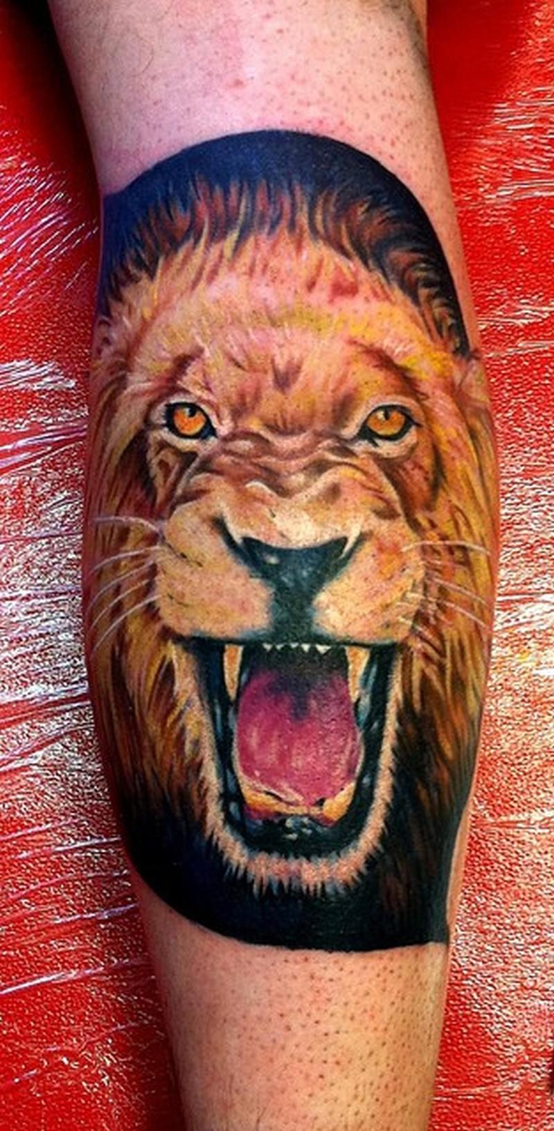 3d lion face tattoo on calf