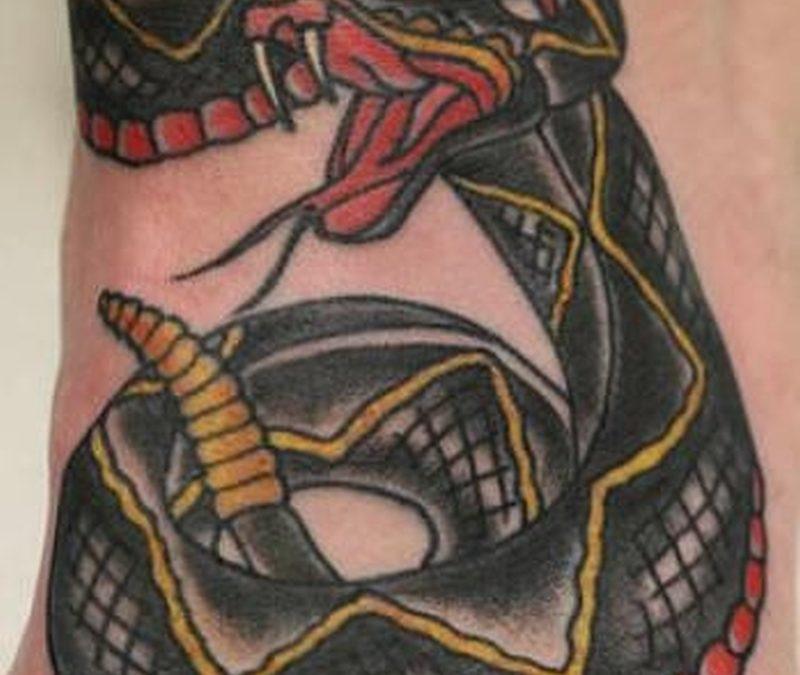 Black Snake On Foot tattoo