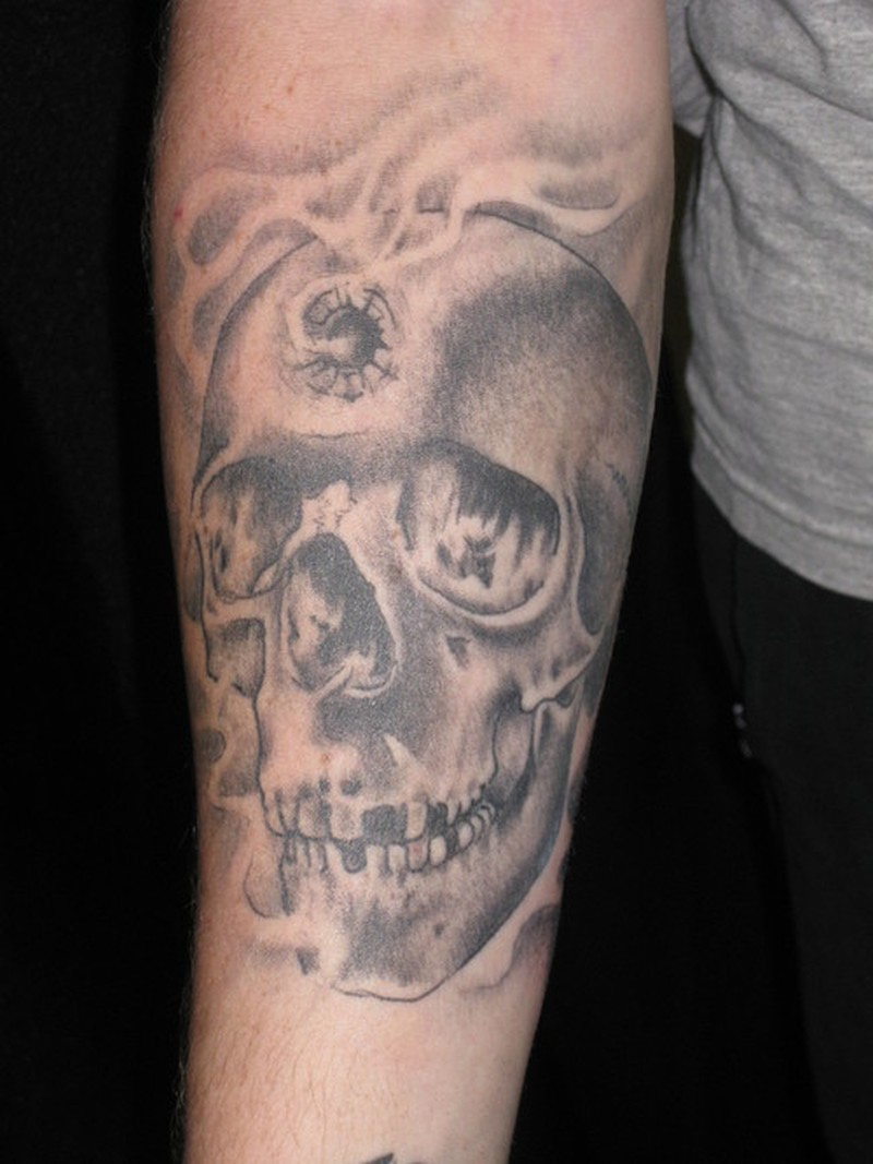 Skull with bullet hole tattoo tattoos book for Bullet tattoo designs