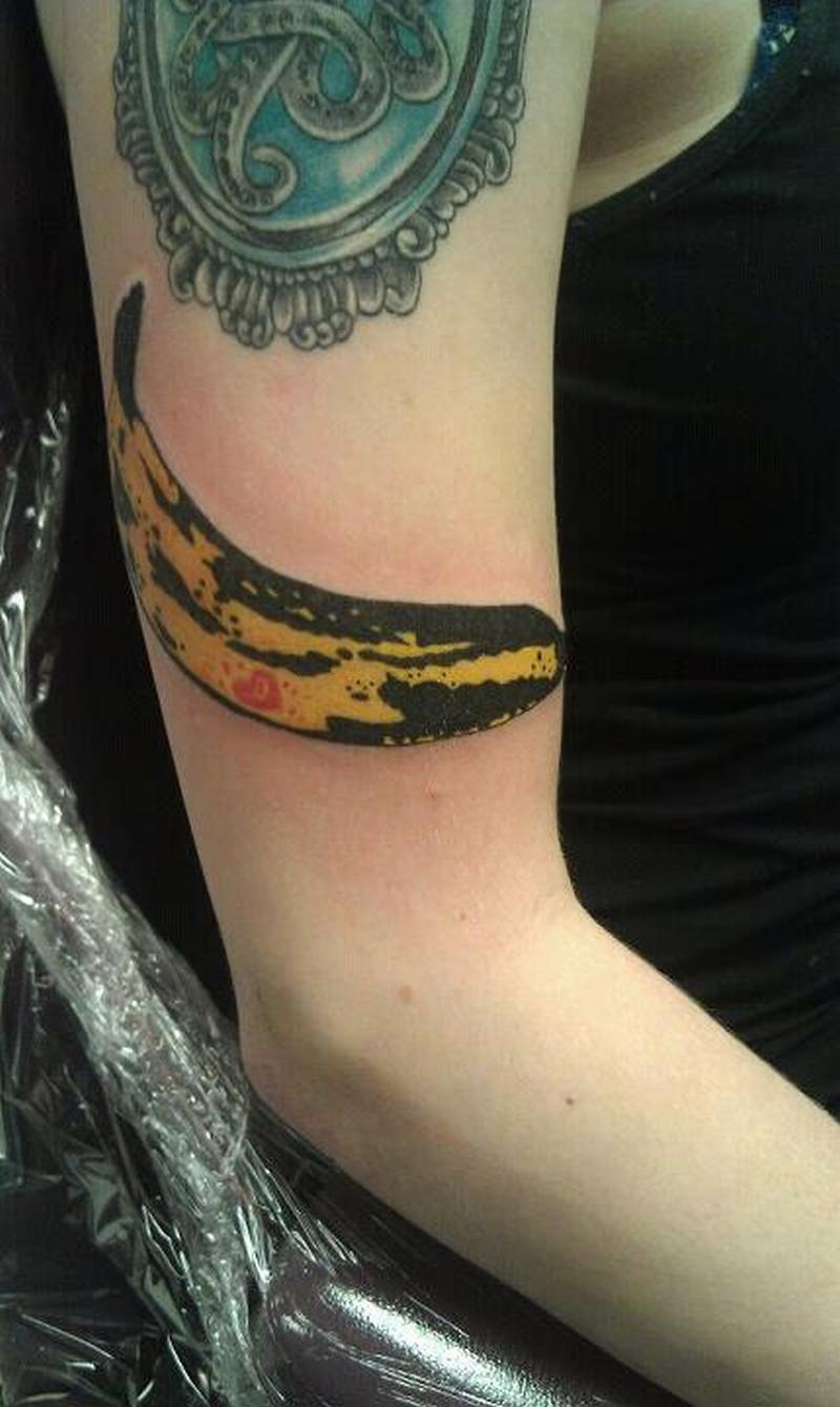 A banana tattoo design on muscles