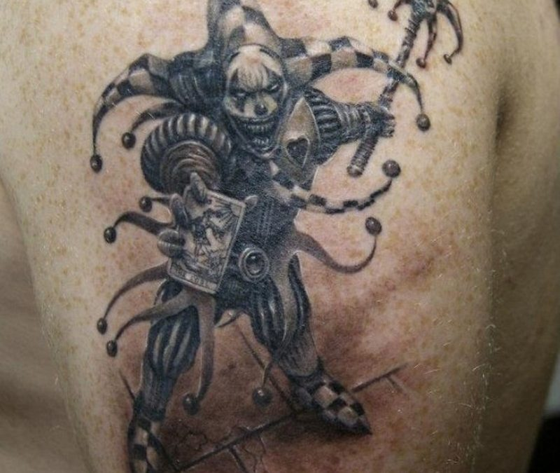 A medieval fantasy jester gets an evil grin in this black n white tattoo