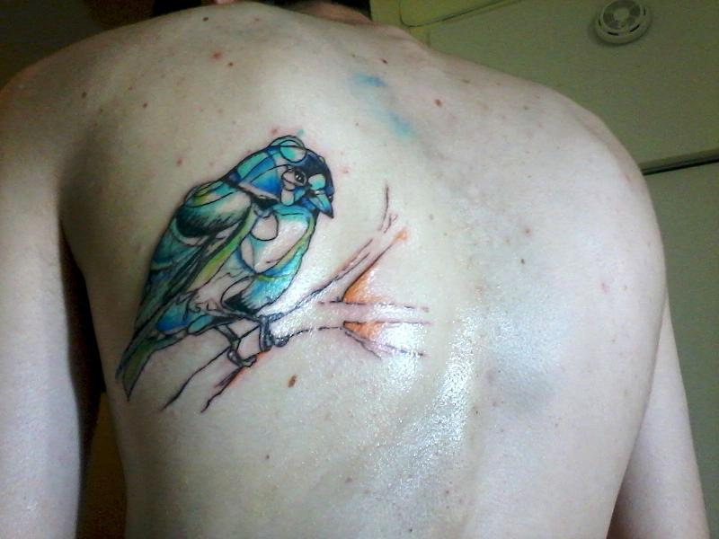 Abstract bird tattoo design on back