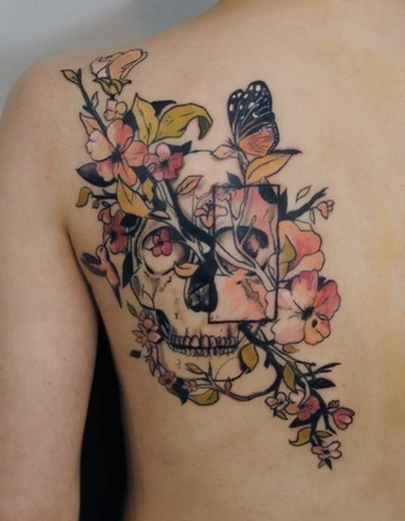 Abstract flowers skull tattoo on back