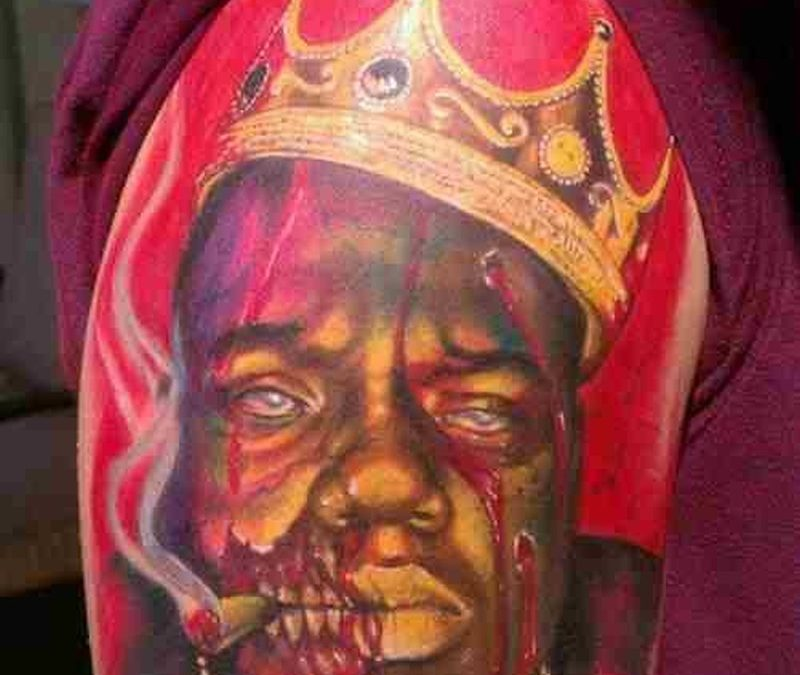 African king zombi tattoo on arm