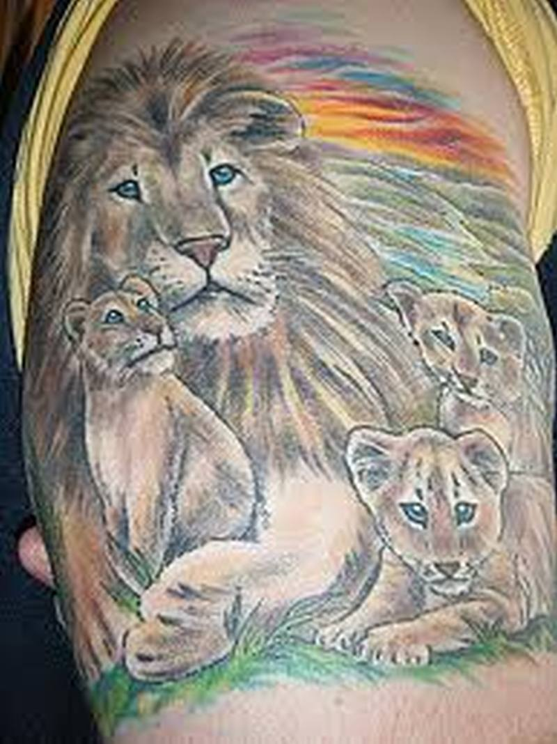 African lion and cubs tattoo on arm