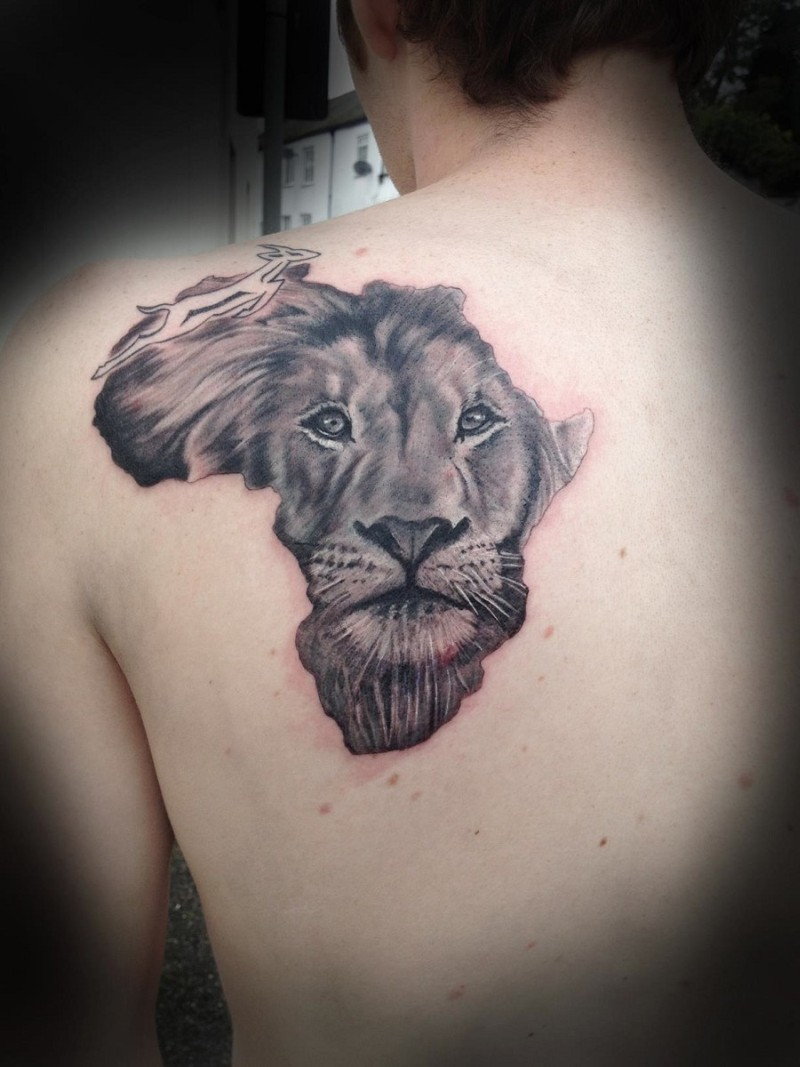 African lion face tattoo on man back