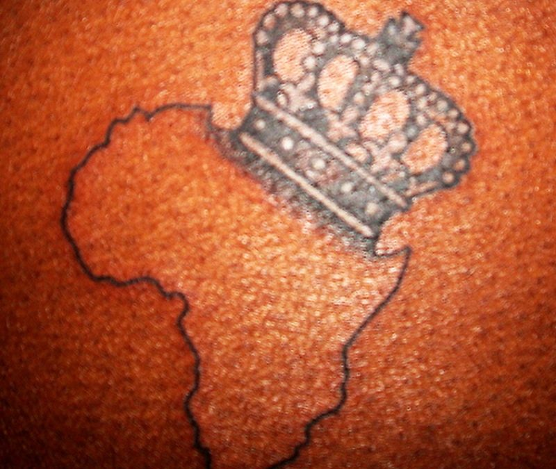 African outline map with crown tattoo