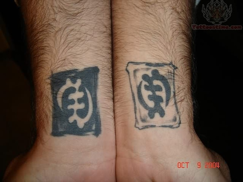 African symbol tattoo on wrist