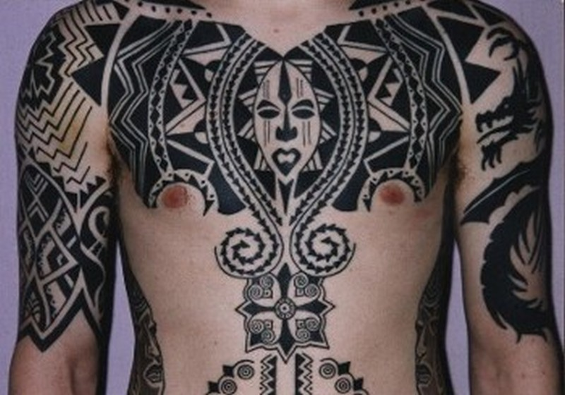 African tattoo on chest