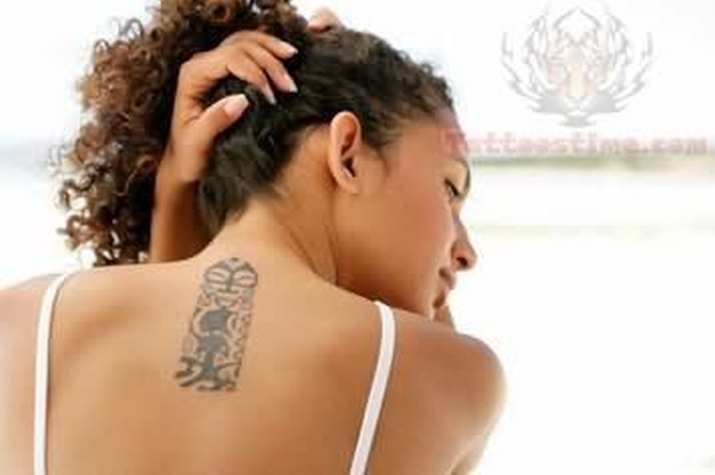 African tattoo on girl back