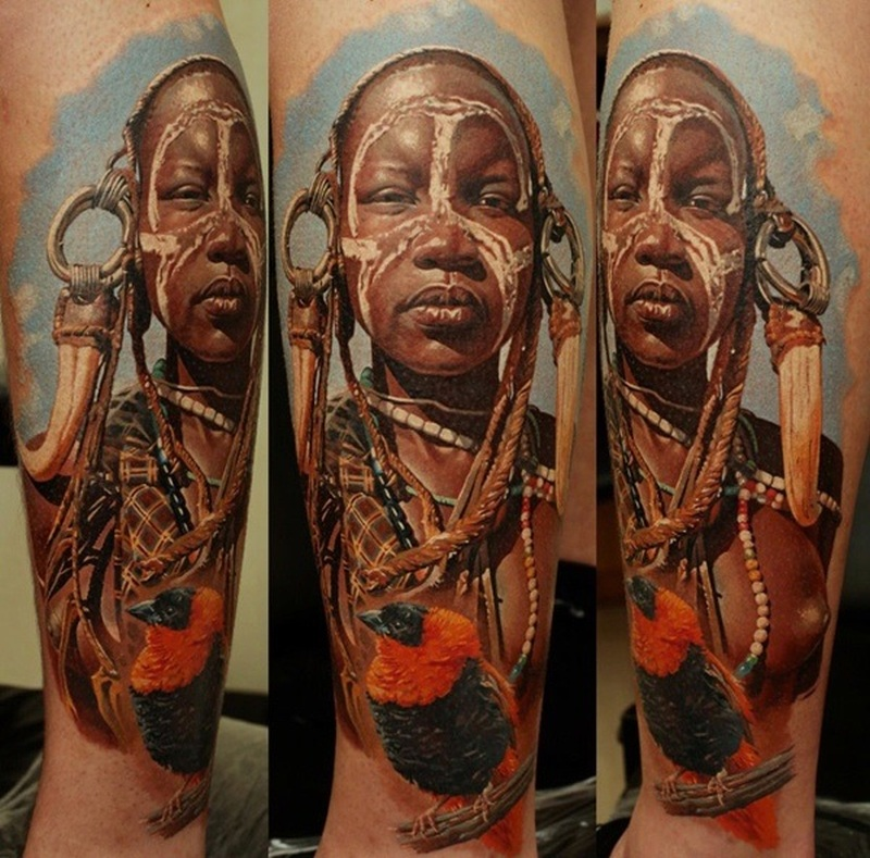 African village woman tattoo on leg