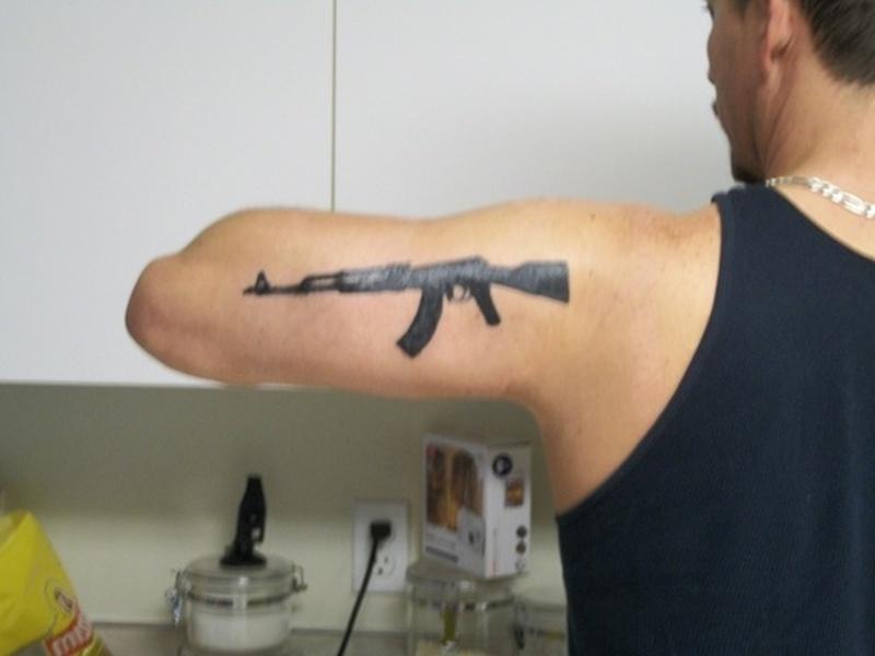 Ak 47 gun tattoo on back of arm tattoos book for Ak 47 tattoo