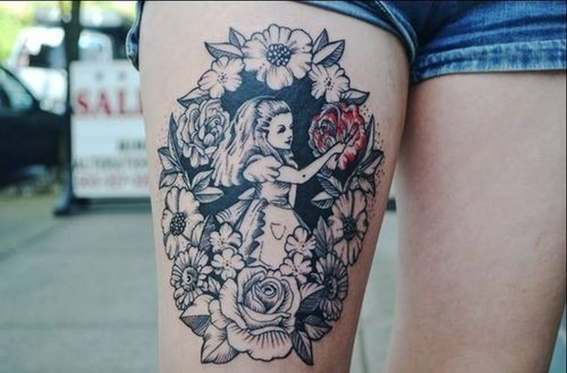 Alice in wonderland tattoo on hip