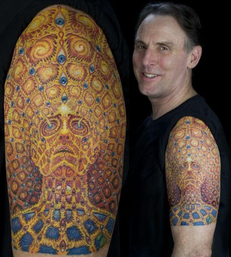 Alien colorful tattoo on biceps shoulder