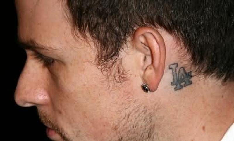 Alphabets tattoo behind ear