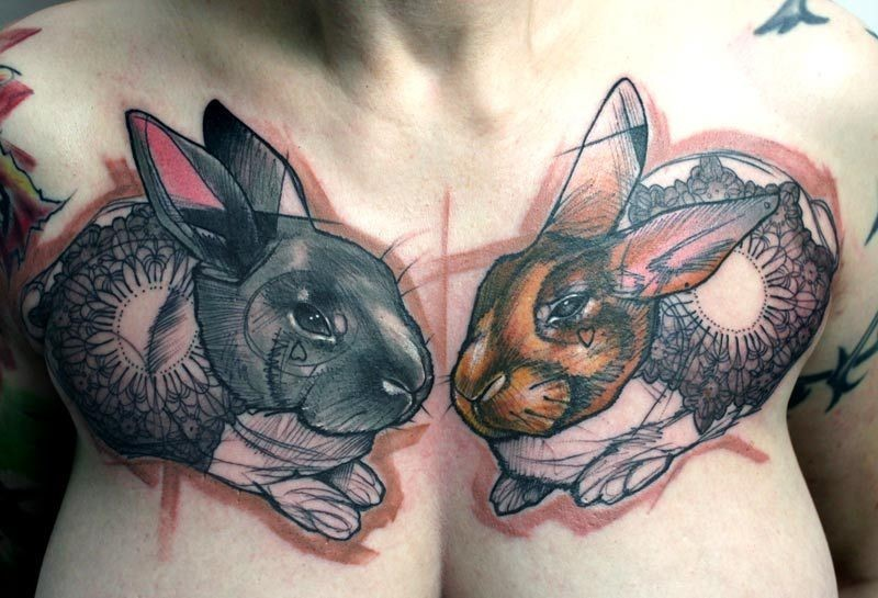 Amasing abstract rabbits tattoo on chest