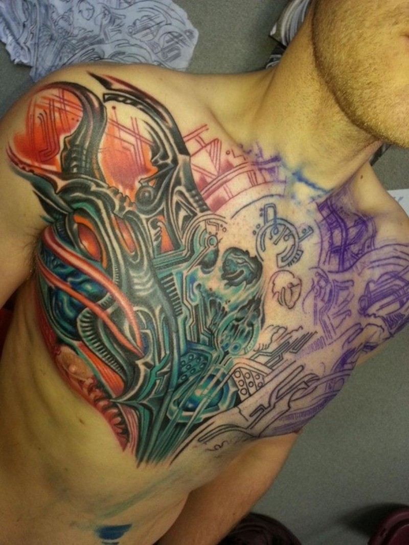 Amasing biomechanical chest tattoo for men