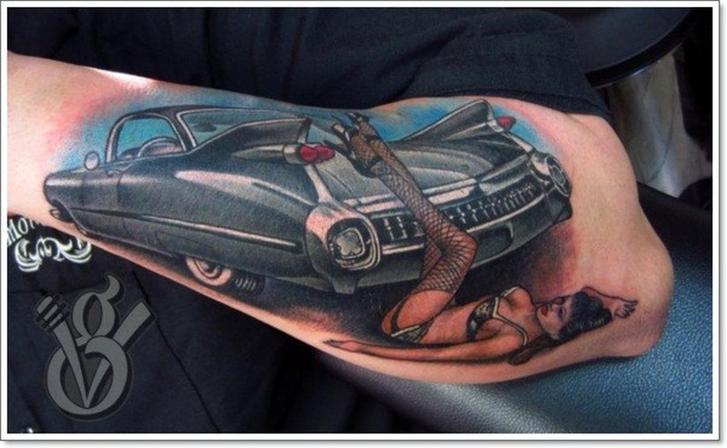 Amasing black cadillac hot rod car with pin up girl forearm tatoo tattoo