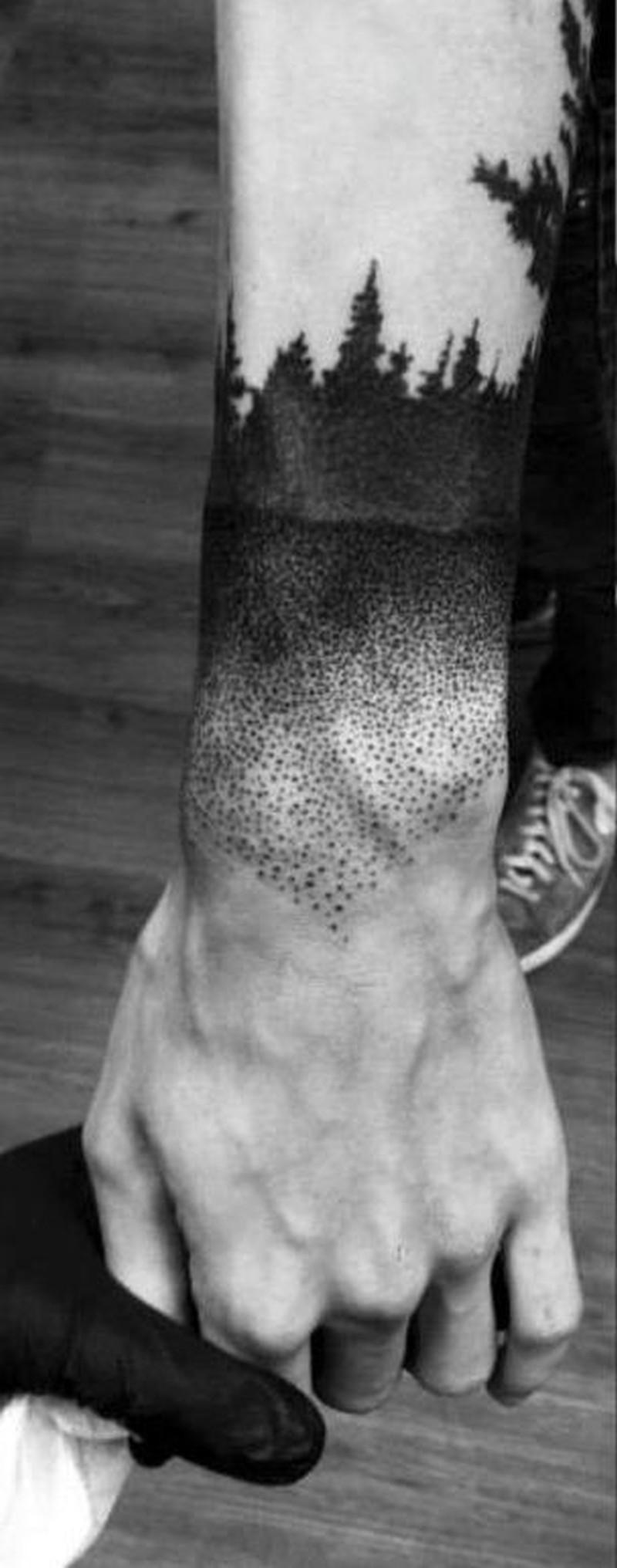 Amasing black forest wrist tattoo