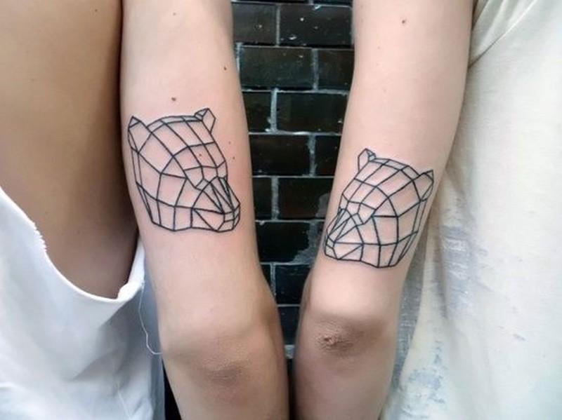 Amasing black lines bear head tattoo on arm