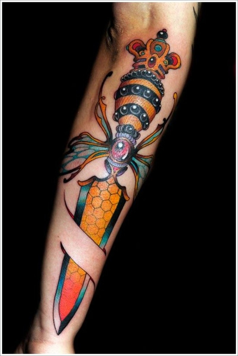 Amasing dagger morphing bee forearm tattoo