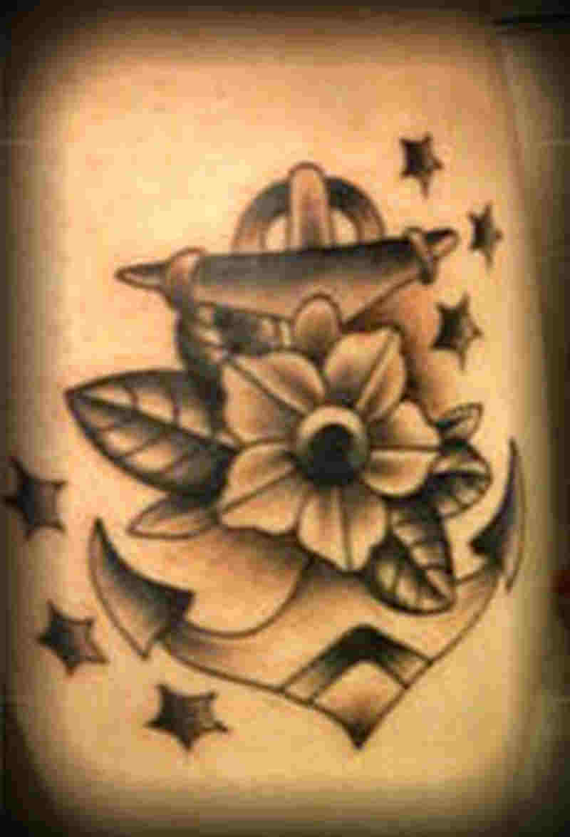 Amazing anchor with flower stars tattoo