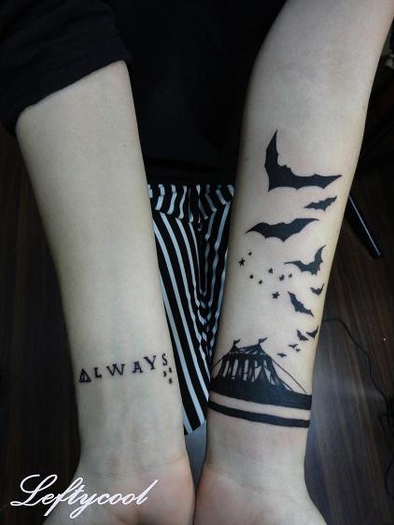 Amazing arm tattoo design of small bats