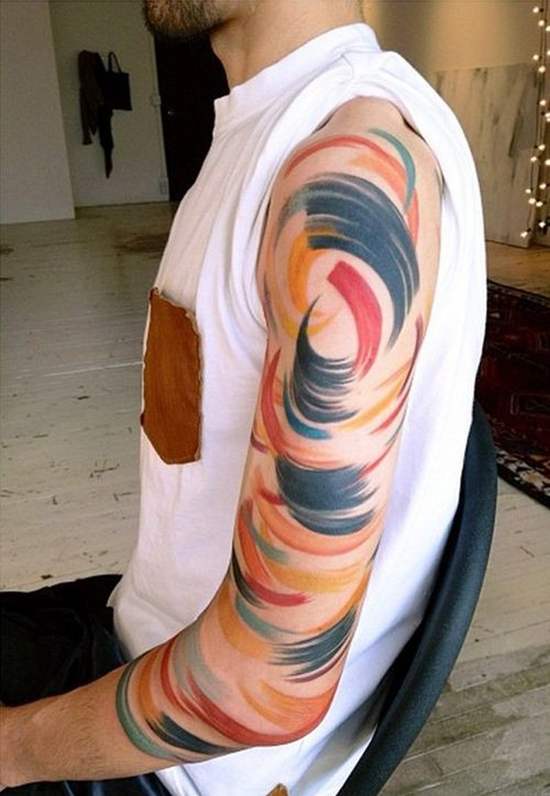 Amazing color abstraction tattoo on arm