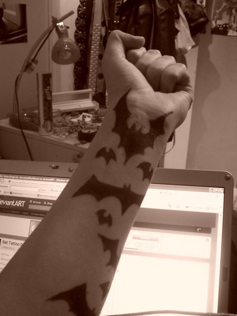 Amazing forearm bats tattoo design