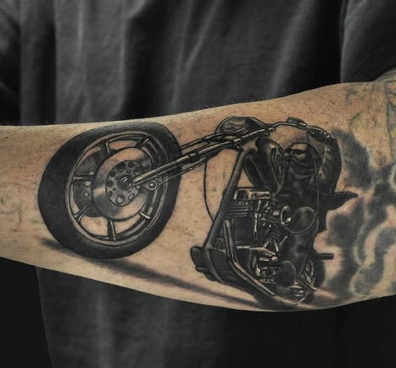 Amazing forearm bike rider tattoo