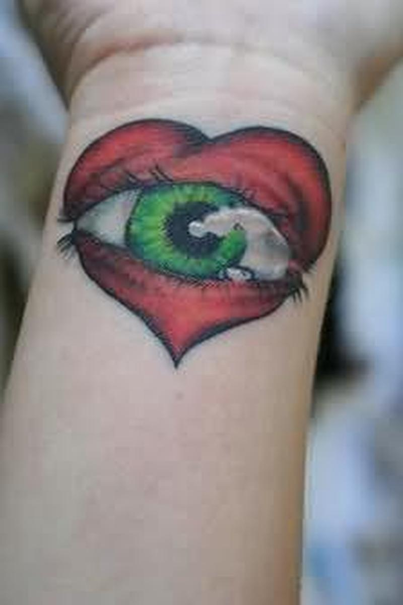 Amazing heart eye tattoo on wrist