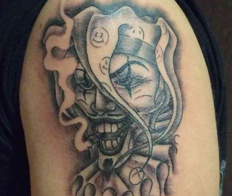 Amazing joker mask tattoo on arm
