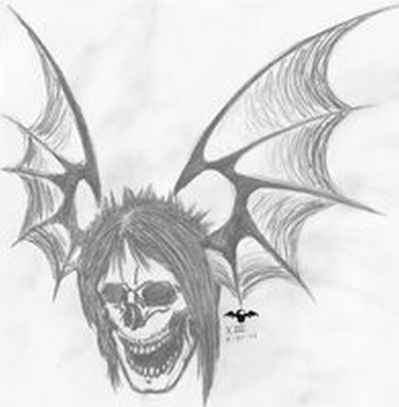 Amazing skull bat tattoo design