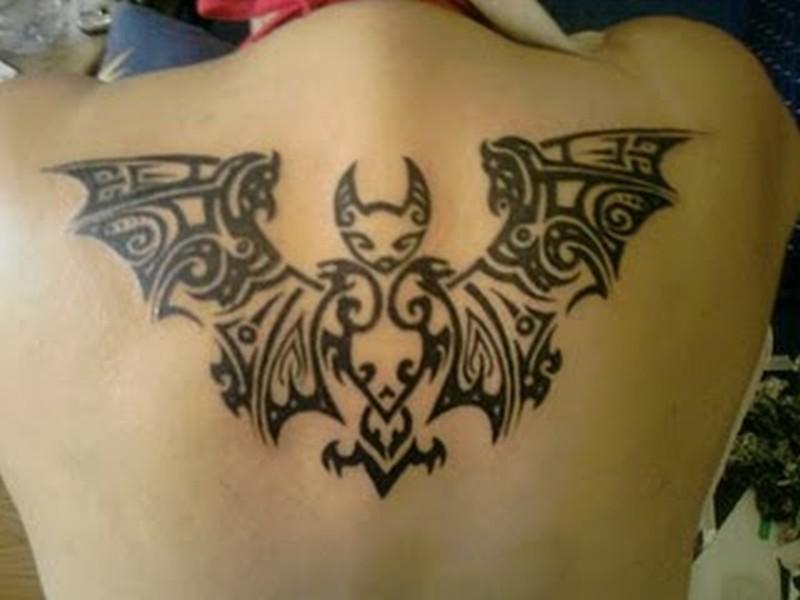 Amazing tribal bats tattoo on upper back