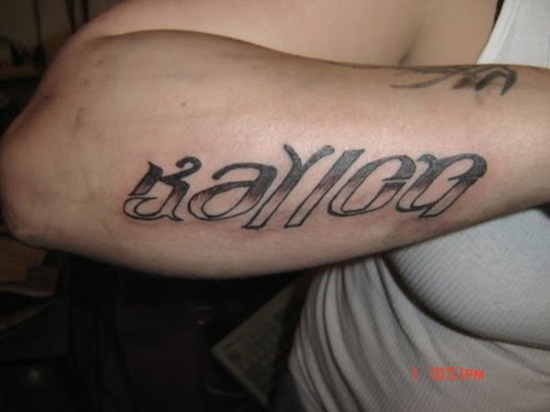 Ambigram tattoo on arm back