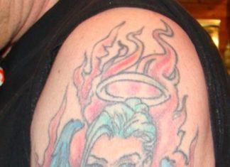 0154b5b05 Angel fire n flame tattoo on biceps · Flame tattoos