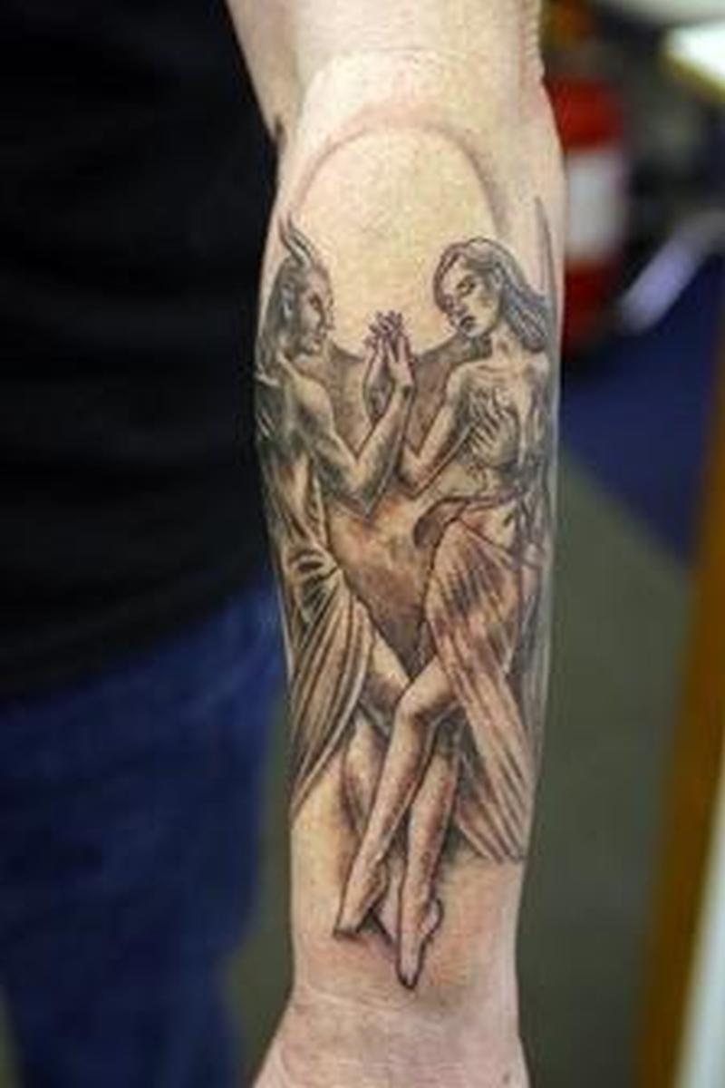 Angel tattoo design on knee