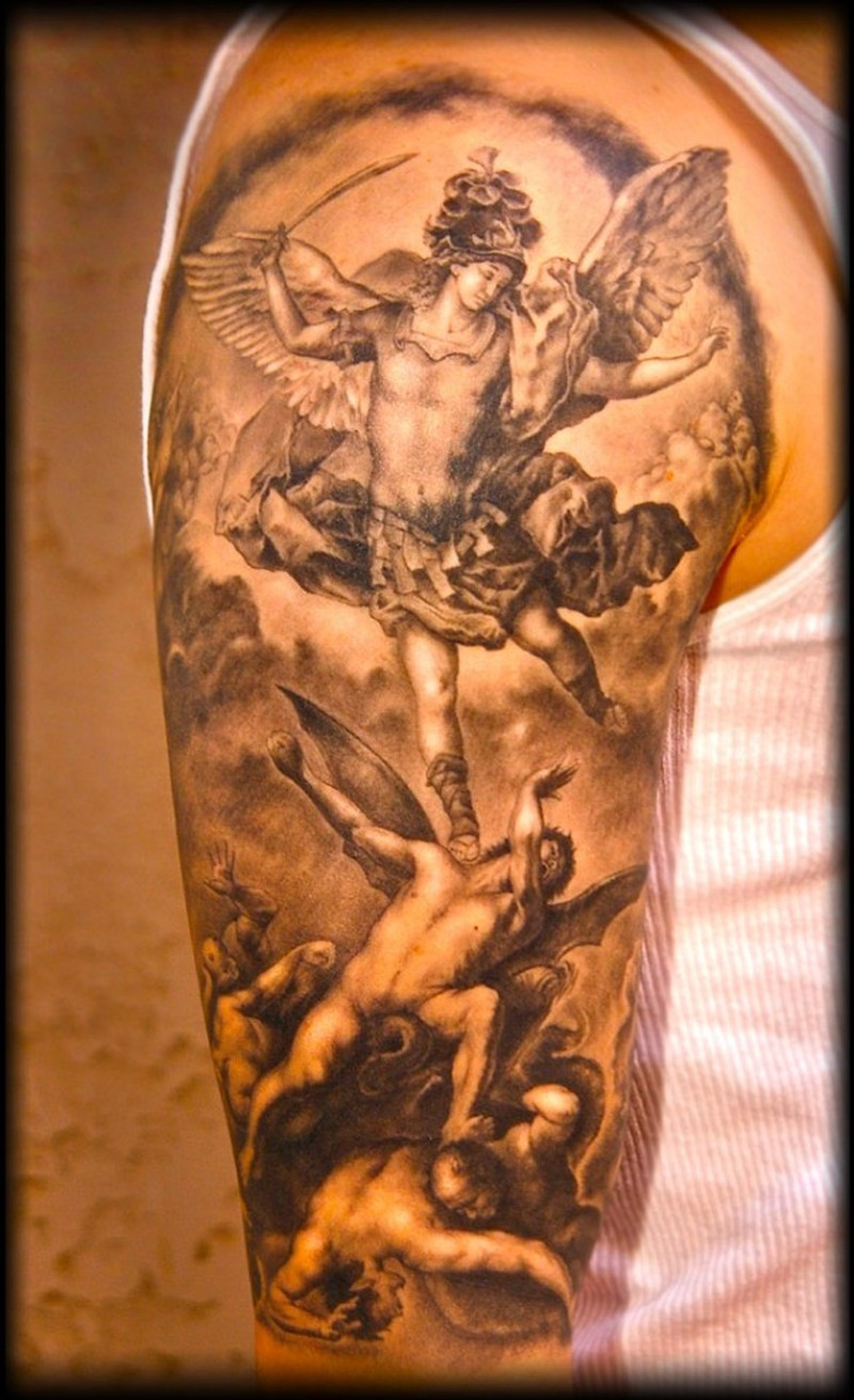 Angel with a sword and demons tattoo on half sleeve