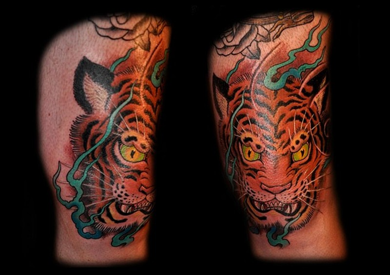 Angry tiger head tattoo designs on knee