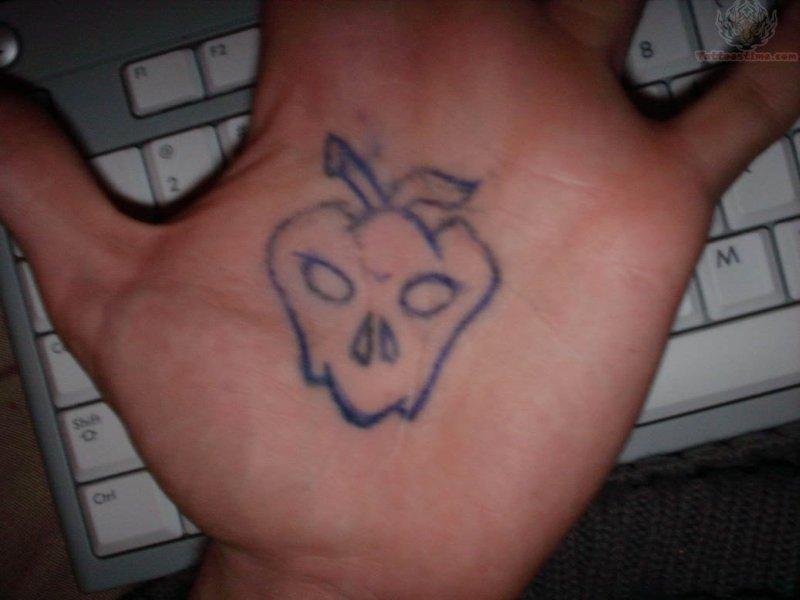 Apple skull tattoo on palm