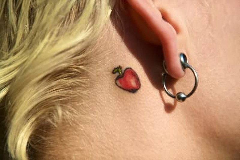 Apple tattoo behind ear