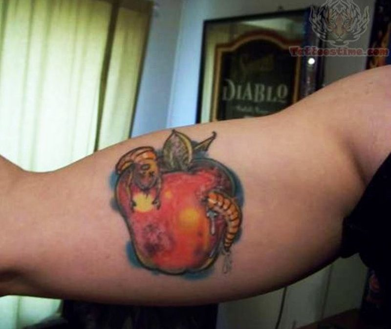 Apple with worm tattoo on muscles