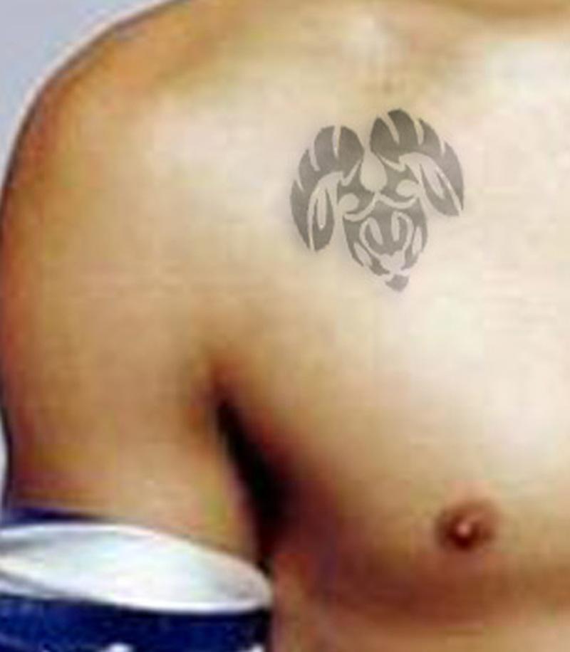 Aries tattoo on collarbone