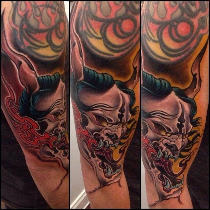 Asian demon tattoo on half sleeve