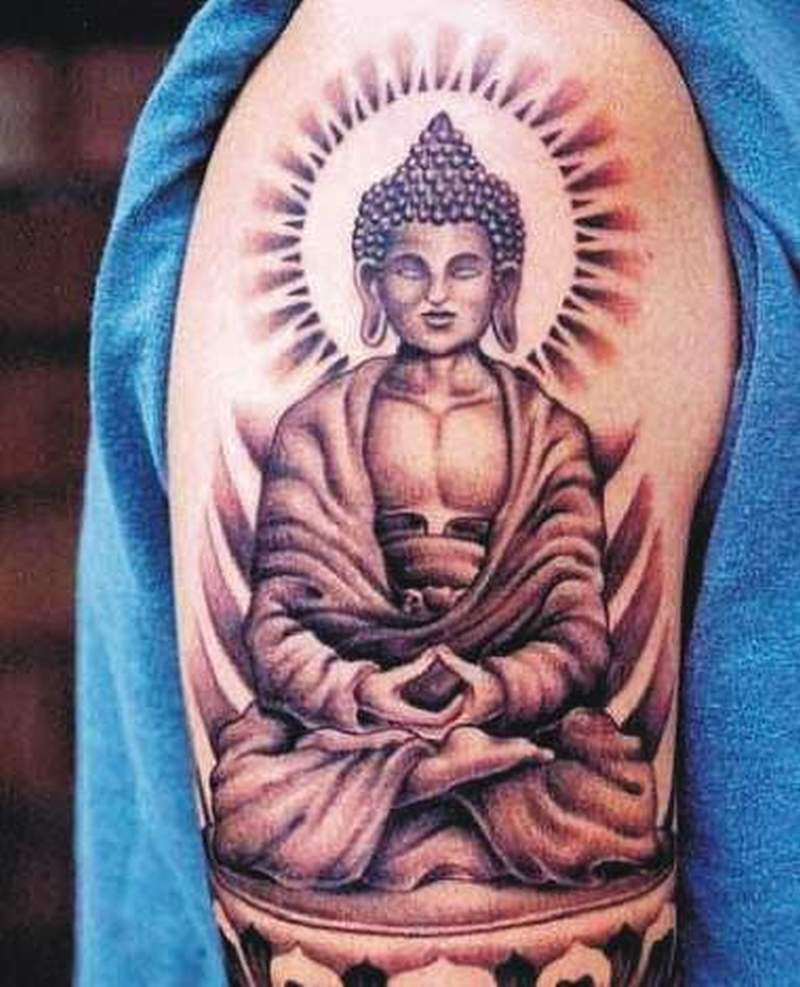 Asian religious tattoo on shoulder