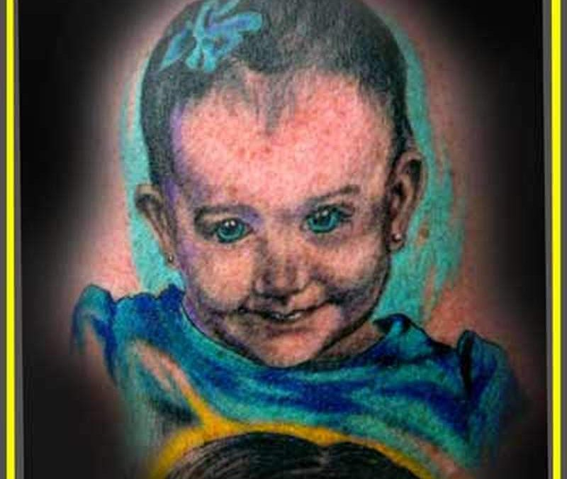 Attractive baby portrait tattoo