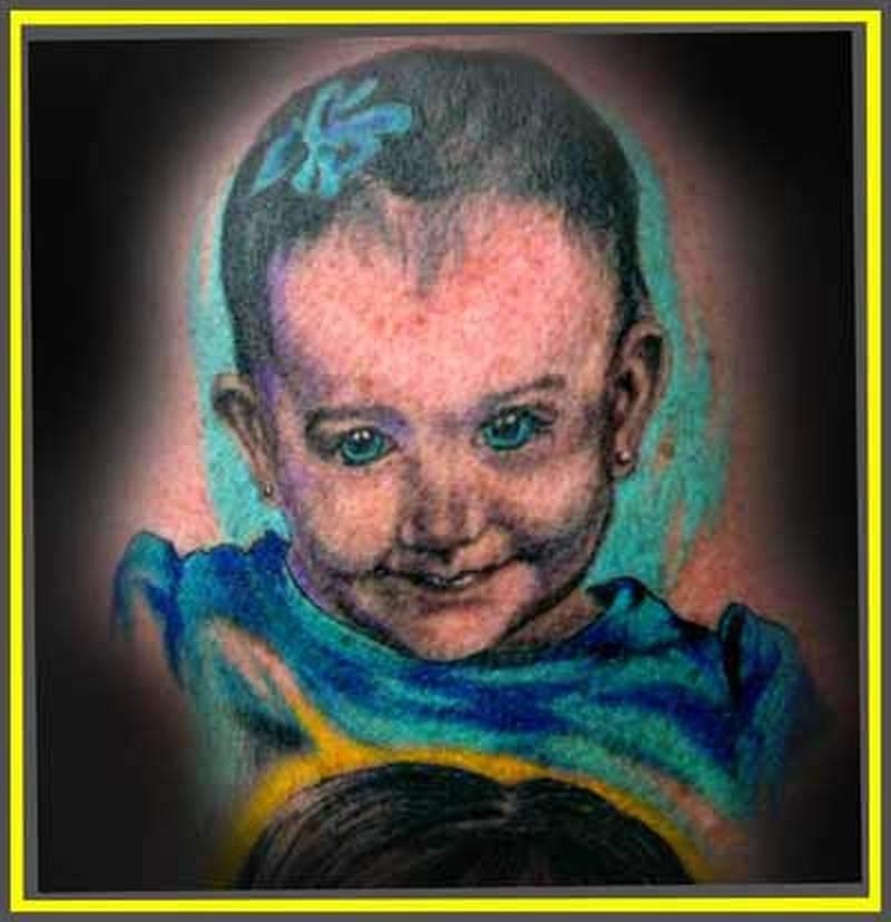 Attractive baby portrait tattoo