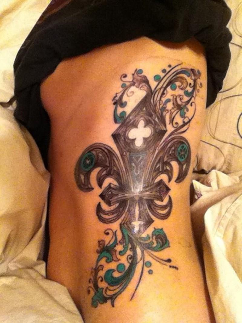 awasing idea of fleur de lis tattoo on ribs for girls. Black Bedroom Furniture Sets. Home Design Ideas