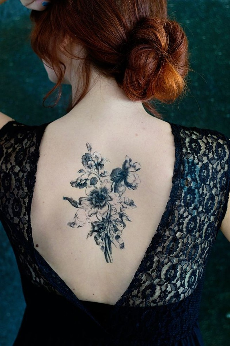 8cb4ce2b75476 Awesome black bouquet of wildflowers tattoo on back - Tattoos Book ...