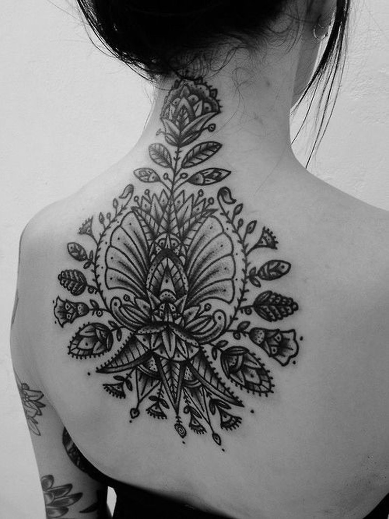 Awesome black grey patterns tattoo on upper back